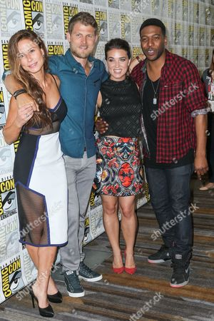 "From left, Rhona Mitra, Travis Van Winkle,Marissa Neitling, and Jocko Sims, attend the ""The Last Ship"" press line on day 1 of Comic-Con International, in San Diego"