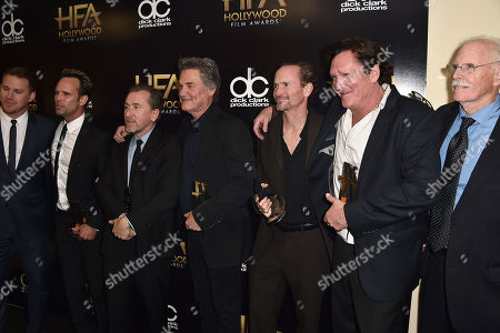 """Channing Tatum, from left, Walton Goggins, Tim Roth, Kurt Russell, James Parks, Michael Madsen and Bruce Dern, winners of the Hollywood ensemble award for """"The Hateful Eight,"""" pose in the press room at the Hollywood Film Awards at the Beverly Hilton Hotel, in Beverly Hills, Calif"""