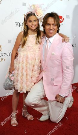 Larry Birkhead (right) and his daughter Dannielynn Birkhead arrive on the red carpet at the 2015 Kentucky Derby on at Churchill Downs in Louisville, Ky