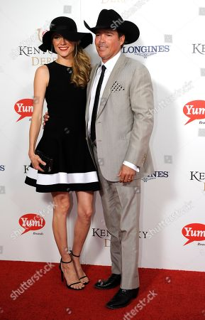 Jessica Walker (left) and Clay Walker arrive on the red carpet at the 2015 Kentucky Derby on at Churchill Downs in Louisville, Ky