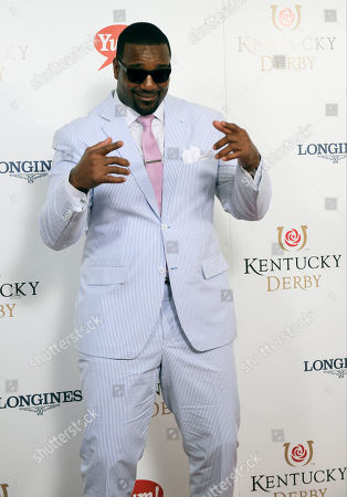 Chris Canty dances on the red carpet at the 2015 Kentucky Derby on at Churchill Downs in Louisville, Ky