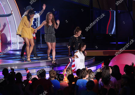 Christen Press, and from left, Christie Rampone, Kelley O'Hara and Hope Solo speak during the 2015 Kids' Choice Sports Awards show at Pauley Pavilion on in Los Angeles