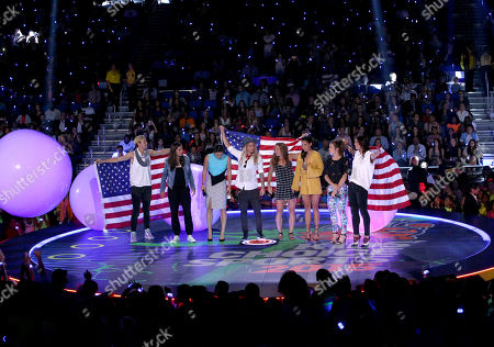 Abby Wambach, and from left, Carli Lloyd, Ali Krieger, Ashlyn Harris, Christie Rampone, Christen Press, Kelley O'Hara, and Hope Solo speak at the 2015 Kids' Choice Sports Awards show at Pauley Pavilion on in Los Angeles