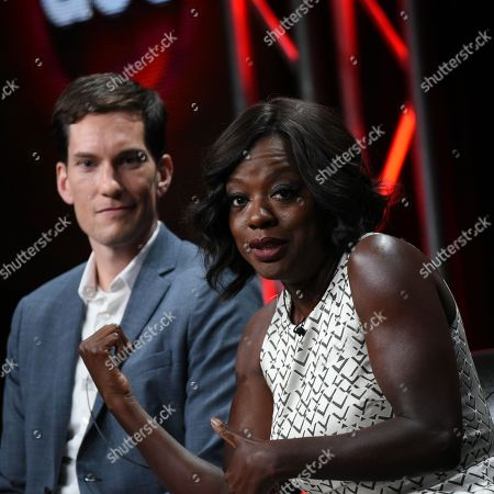 """Creator/Executive Producer Peter Nowalk, left, and actress Viola Davis speak onstage during the """"Grey's Anatomy, Scandal, and How to Get Away with Murder"""" panel at the Disney/ABC Summer TCA Tour held at the Beverly Hilton Hotel, in Beverly Hills, Calif"""