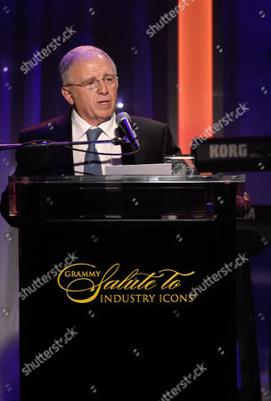 Irving Azoff accepts the President's Merit Award at the 2016 Clive Davis Pre-Grammy Gala at the Beverly Hilton Hotel, in Beverly Hills, Calif