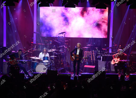 Pat Smear, from left, Dave Grohl, Beck, and Krist Novoselic perform at the 2016 Clive Davis Pre-Grammy Gala at the Beverly Hilton Hotel, in Beverly Hills, Calif