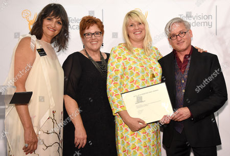 The Television Academy's Terry Ann Gordon, from left, Sue Bub, Marie Schley, and Mark A. Summers pose with a plaque for their Emmy nomination for Transparent at the 10th Annual Art of Television Costume Design Exhibition opening at the FIDM Museum & Galleries on the Park, in Los Angeles