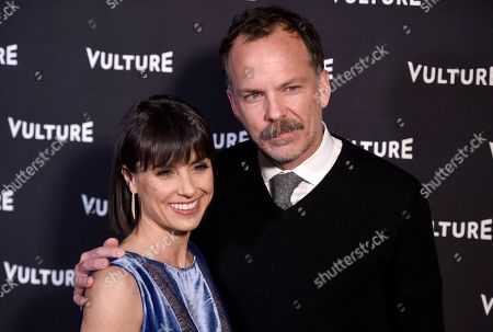 Constance Zimmer, left, and Russ Lamoureux arrive at the New York Magazine and Vulture inaugural awards season party at the Sunset Tower Hotel, in Los Angeles