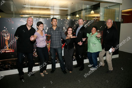 From left to right, moderator Shawn Ryan and editors Moira Demos, Kabir Akhtar, ACE, Nena Erb, Robert Malachowski, ACE, Kelley Dixon, ACE and Stephen Prime pose during the 2016 Prime Cuts hosted by the Television Academy in the Wolf Theater on in the NoHo Arts District in Los Angeles