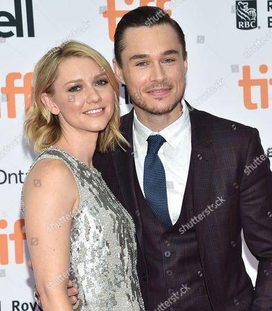 Valorie Curry, left, and Sam Underwood arrive at the American Pastoral premiere on day 2 of the Toronto International Film Festival at the Princess of Wales Theatre, in Toronto