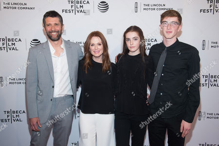"""Bart Freundlich, left, Julianne Moore, Liv Freundlich and Caleb Freundlich attend the world premiere screening of """"Wolves"""" during the 2016 Tribeca Film Festival at the SVA Theatre, in New York"""