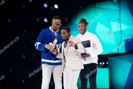 "From left, Kardinal Offishall, Michael ""Pinball"" Clemons and Tyrone Edwards seen on stage at WE Day, in Toronto"