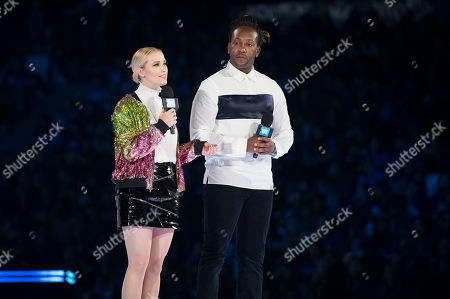 Stock Image of Liz Trinnear, left, and Tyrone Edwards seen on stage at WE Day, in Toronto