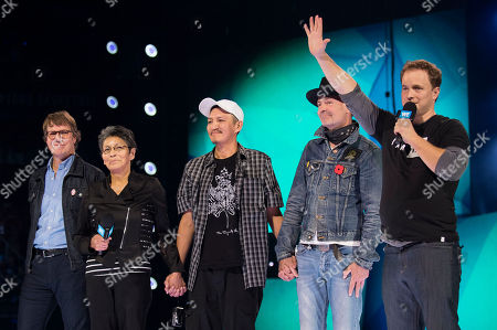 From left, Mike Downie, Pearl Achneepineskum, William Achneepineskum, Gord Downie and Marc Kielburger seen during WE Day, in Toronto