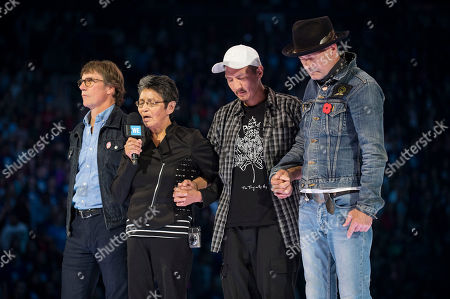 Stock Picture of From left, Mike Downie, Pearl Achneepineskum, William Achneepineskum and Gord Downie seen during WE Day, in Toronto