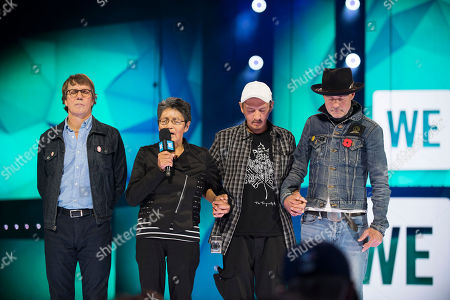 Stock Image of From left, Mike Downie, Pearl Achneepineskum, William Achneepineskum and Gord Downie seen during WE Day, in Toronto