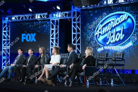 "Stock Image of Scott Borchetta, from left, Ryan Seacrest, Keith Urban, Jennifer Lopez, Harry Connick, Jr. and executive producer Trish Kinane participate in the ""American Idol"" panel at the Fox Winter TCA, Pasadena, Calif"