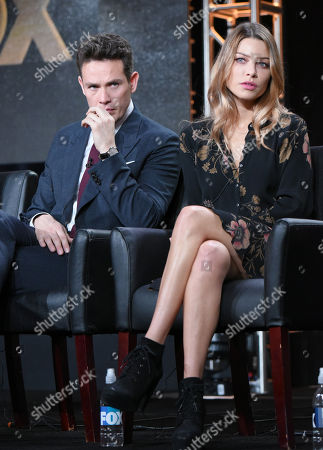"Kevin Alejandro, left, and Lauren German participate in the ""Lucifer"" panel at the Fox Winter TCA, Pasadena, Calif"