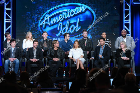 "Nick Fradiani, back row from left, Lauren Alaina, Scotty McCreery, Kris Allen, David Cook, Jordin Sparks, Ruben Studdard and, front row from left, Scott Borchetta, Ryan Seacrest, Keith Urban, Jennifer Lopez, Harry Connick, Jr. and executive producer Trish Kinane participate in the ""American Idol"" panel at the Fox Winter TCA, Pasadena, Calif"
