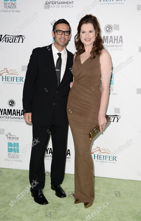 """Actress Geena Davis, left, and her husband Reza Jarrahy arrive at the 2nd Annual """"Beyond Hunger: A Place at the Table"""" at the Montage Beverly Hills Hotel on in Beverly Hills, Calif"""