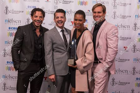 "Rene Rosado, from left, Jonathan Del Arco, Kearran Giovanni, and Phillip Keene pose with the 2016 Television Best Primetime Program Drama award for ""Major Crimes"" at the 31st Annual Imagen Awards ceremony, in Beverly Hills, CA"
