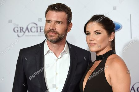 Scott Foley, left, and Marika Dominczyk arrive at the 41st annual Gracie Awards Gala at the Beverly Wilshire Hotel, in Beverly Hills, Calif