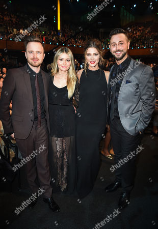 Aaron Paul, from left, Lauren Parsekian, Ashley Greene, and Paul Khoury pose in the audience at the 5th annual NFL Honors at the Bill Graham Civic Auditorium, in San Francisco