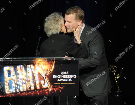 Stock Image of From left, actress June Lockhart presents the Emmy Engineering Award to YouTube Engineering Director, Jason Gaedtke onstage at the 65th Primetime Emmy Engineering Awards,, at Loews Hollywood Hotel, in Hollywood, Calif
