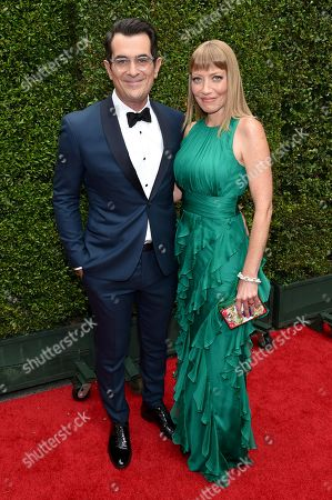 Ty Burrell, left, and Holly Anne Brown arrives at the 66th Primetime Emmy Awards at the Nokia Theatre L.A. Live, in Los Angeles
