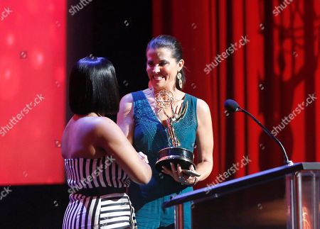 Niecy Nash, left, presents Lu Parker from KTLA5/KTLA5 News At Ten with the Emmy for Light News Story (Single Report) for Homeless Headshots at the L.A. Area Emmy Awards presented at the Television Academy's new Saban Media Center, in the NoHo Arts District in Los Angeles