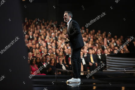 Stock Image of Miguel Sapochnik accepts the award for outstanding directing for a drama series for Game of Thrones at the 68th Primetime Emmy Awards, at the Microsoft Theater in Los Angeles