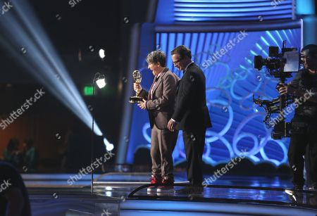 Director Jill Soloway accepts Outstanding Directing for a Comedy Series for the 'Transparent' episode 'Man on the Land' with Peter Scolari at the 68th Primetime Emmy Awards, at the Microsoft Theater in Los Angeles