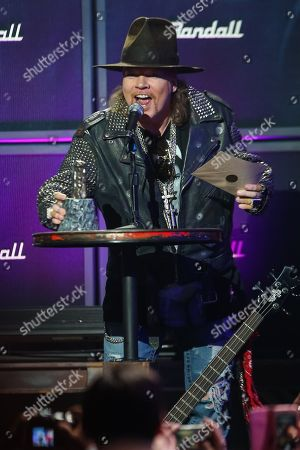 Stock Photo of Axl Rose of Guns N' Roses receives the Ronnie James Dio Lifetime Achievement Award at the 6th Annual Revolver Golden Gods Award Show at Club Nokia on in Los Angeles, California