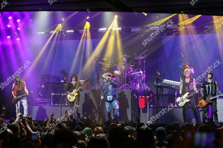 """From left, guitarist Ron """"Bumblefoot"""" Thal, guitarist Richard Fortus, Vocalist Axl Rose, Drummer Frank Ferrer, bassist Duff McKagan, keyboardist Chris Pitman, and guitarist DJ Ashba of Guns N' Roses perform on stage at the 6th Annual Revolver Golden Gods Award Show at Club Nokia on in Los Angeles, California"""