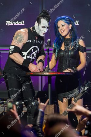 Doyle Wolfgang von Frankenstein of The Misfits, left, and Alissa White-Gluz of Arch Enemy speak on stage at the 6th Annual Revolver Golden Gods Award Show at Club Nokia on in Los Angeles, California