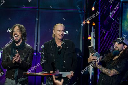 From left, Richie Kotzen, Billy Sheehan, and Mike Portnoy speak on stage at the 6th Annual Revolver Golden Gods Award Show at Club Nokia on in Los Angeles, California