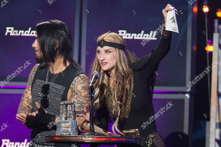Dave Navarro of Jane's Addiction, left, and Jill Janus of Huntress speak on stage at the 6th Annual Revolver Golden Gods Award Show at Club Nokia on in Los Angeles, California