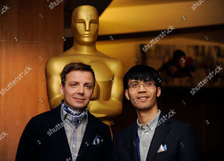 "Stock Picture of Mark Gill, left, and Baldwin Li, co-filmmakers of the Oscar-nominated live action short film ""The Voorman Problem,"" pose together at a reception featuring the Oscar nominees in the Animated and Live-Action Short Film categories, in Beverly Hills, Calif. The Oscars will be held on Sunday at the Dolby Theatre in Los Angeles"