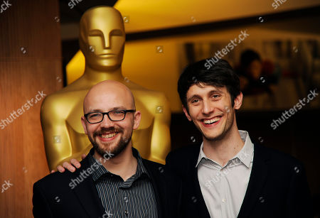 """Max Lang, left, writer/co-director of the Oscar-nominated animated short film """"Room on the Broom,"""" and co-director Jan Lachauer pose together at a reception featuring the Oscar nominees in the Animated and Live-Action Short Film categories, in Beverly Hills, Calif. The Oscars will be held on Sunday at the Dolby Theatre in Los Angeles"""