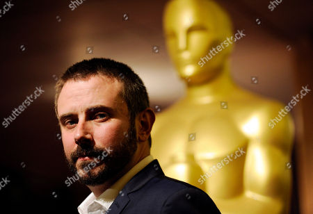 """Stock Picture of Journalist Jeremy Scahill, co-writer and cast member of the Oscar-nominated documentary film """"Dirty Wars,"""" poses at a reception featuring the Oscar nominees in the Documentary Feature and Documentary Short Subject categories, in Beverly Hills, Calif. The Oscars will be held on Sunday at the Dolby Theatre in Los Angeles"""
