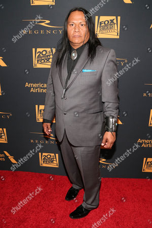 "Navajo actor Arthur Redcloud, from the film, ""The Revenant,"" arrives at the Fox 88th Academy Awards after party, at the Hollywood Athletic Club in Los Angeles"