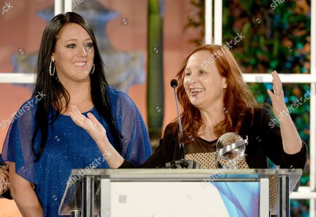 """Katrina Gilbert, left, and Shari Cookson accept a Television Academy Honors award for """"Paycheck to Paycheck: The Life and Times of Katrina Gilbert"""" at the 8th annual Television Academy Honors at the Montage hotel, in Beverly Hills, Calif"""