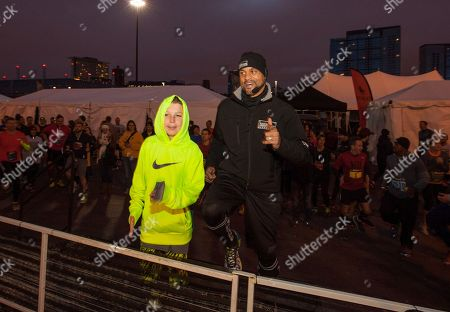 Camren Hagan and celebrity fitness trainer Shaun T during the 9th annual Men's Health Urbanathlon presented by Polo Red by Ralph Lauren, outside Soldier Field on in Chicago