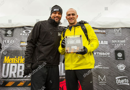 Host and celebrity fitness trainer Shaun T and Classic Distance winner male division Justin Stewart, during the 9th annual Men's Health Urbanathlon presented by Polo Red by Ralph Lauren, outside Soldier Field on in Chicago