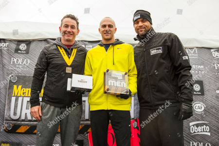 Men's Health VP/Publisher Ronan Gardiner, Classic Distance winner male division Justin Stewart with host and celebrity fitness trainer Shaun T, during the 9th annual Men's Health Urbanathlon presented by Polo Red by Ralph Lauren, outside Soldier Field on in Chicago