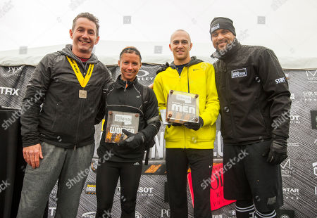 Released, Men's Health VP/Publisher Ronan Gardiner, Classic Distance winner female division Angela Matthews, Classic Distance winner male division Justin Stewart and host and celebrity fitness trainer Shaun T, during the 9th annual Men's Health Urbanathlon presented by Polo Red by Ralph Lauren, outside Soldier Field on Saturday, Oct. 18, 2014 in Chicago