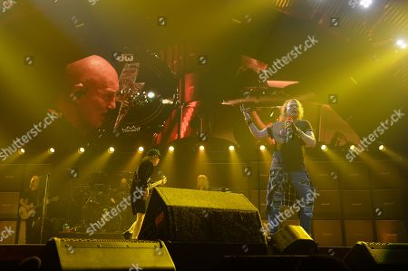 Axl Rose, Stevie Young, Chris Slade, Angus Young and Cliff Williams of AC DC perform during the Rock or Bust Tour 2016 at the BB&T Center on in Sunrise, Fla