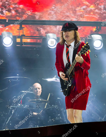 AC/DC's Angus Young, right, and Chris Slade perform during their Rock Or Bust World Tour at Gillette Stadium on in Foxborough, Mass