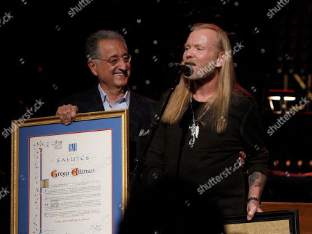 Stock Picture of Gregg Allman received an award from Del Bryant, President of BMI during the show at All My Friends: Celebrating The Songs and Voice of Gregg Allman on in Atlanta, Ga