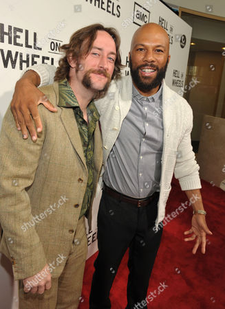 "Phil Burke and Common attend a special screening of the second season premiere of AMC's ""Hell on Wheels"" on in Beverly Hills, Calif"